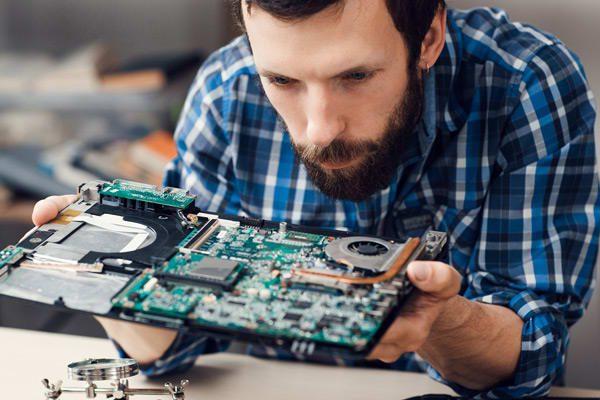 Man examining PCB
